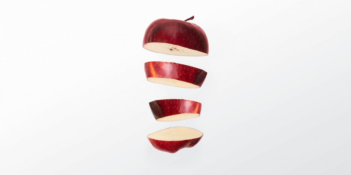 Sliced apple in mid air