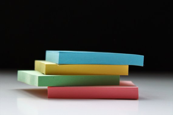 colorful sticky notes stacked on top of one another