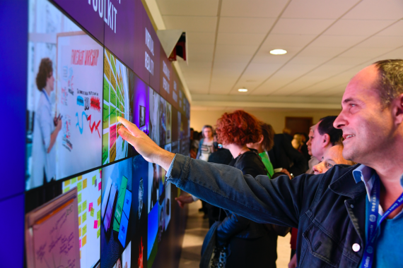 Man touching interactive video wall